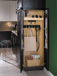 Diamond Cabinetry's drop zone cabinet with charging station, key hooks, coat hooks, and magnetic whiteboard on inside of door -- photo from here: http://www.houzz.com/photos/1157031/Diamond-Cabinetry-traditional-kitchen-indianapolis