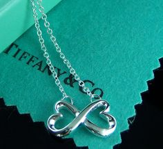 Paloma Picasso Double Loving Heart Pendant. Simple yet elegant.  You can wear this with almost anything.