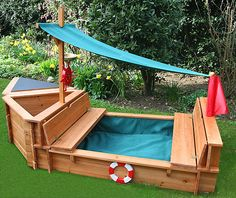 sandpit....soooooooo cute and I could totally make it...just with more coverage for the sandbox part....since it rains here A LOT!