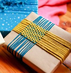 yarn decorations on gifts, craft paper