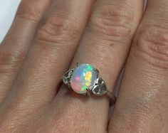 RAINBOW colored fire opal silver ring with a new ring design featuring white topaz micro paved band, classic blue base, red fire AAA Opal