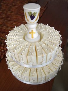 Communion Chalice Centerpiece Cake With Favors http://www.alittlefavor.com/products/79/cp614FirstCommunioncake/communion-chalice-centerpiece-cake-with-favors.html