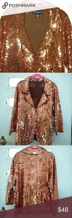 Jacket Bronze color blingy jacket by Colleen Lopez and My favorite Things.Beyond Gorgeous in Person.This jacket will get you noticed.Not to much bling, just the right amount.This color is to die for.Very light and comfy.The inside is a brown sweater that blends in perfect with the bling.Says 2 x,but fits more like XL.Depends on how you want it to fit. MY FAVORITE THINGS Jackets & Coats Blazers