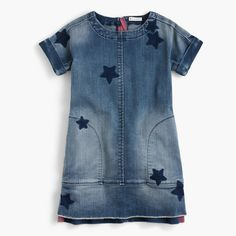 Made from artfully-distressed denim decorated with a fun star print, this short-sleeved shift is a perfect back-to-school dress. (When the temperature drops, she can layer it over tights and a turtleneck.) Shift silhouette. Falls above knee. Cotton/elastane. Machine wash. Import. Select stores.