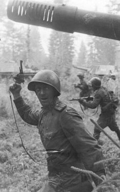 A Kalashnikov Soviet Army officer leads his combat unit with the support of heavy sauk.