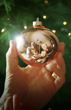 family photo idea - Christmas, reflected photo of parents and kids in bauble / creative Christmas family pictures