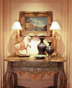 Nice and interesting grouping, the horse and vases act as the same in proportion and give this grouping a symmetrical look, without out being boring.