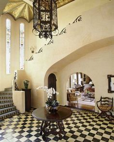 "The black and cream, checkered marble floor was original to this Spanish Revival home in Beverly Hills,"" says Thomas Callaway. Here, the stained-glass windows and the gilded ceiling were also original Spanish Revival Home, Spanish Colonial, Home Design, Set Design, Interior Design, Checkered Floors, Foyer Decorating, Los Angeles Homes, Marble Floor"