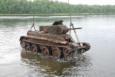 "WWII Russian Model ""BT"" Tank (translated as ""Quick Moving Tank"") was extracted from one of the lakes near St. Petersburg."