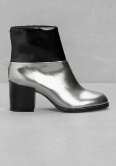 & OTHER STORIES Featuring a chunky heel and an exposed zipper in the back, these patent black and silver leather boots completes a bold autumn look.