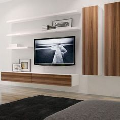 This charming floating composition which combines the BRANDO floating entertainment unit, wall cabinets and floating shelves is the ultimate storage solution for your home media setup