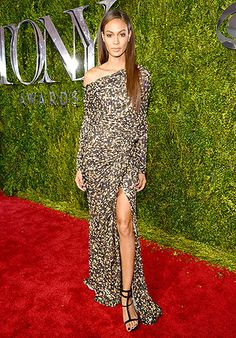 Joan Smalls selected a long-sleeved dress with an asymmetrical neckline and an up-to-there slit. Strappy sandals completed the look.
