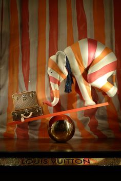 Louis Vuitton window display. 2 of my favs together lol elephants and Louis lol
