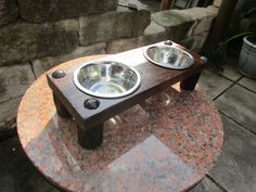 This is a small rustic looking pet feeder or bowl holder, whichever you prefer to call it. It is very short for small dogs or cats. It will