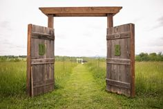Rustic barn door wedding decor is quickly becoming the new wedding trend!  Love the moss initial details.  doors and weddings.  wedding decor.  rustic wedding.  vintage wedding.  outdoor wedding. country wedding. repurposed doors.