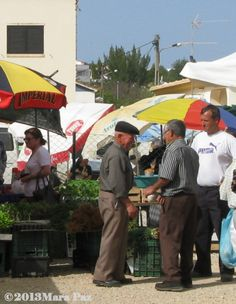 Locals at the monthly market in Algoz - shopping and catching up on ...