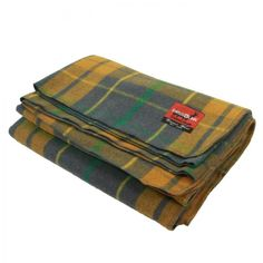 """New Wool Plaid Blankets (Grey/Tan) We had these most beautiful plaid blankets made in many different colors now. They are 80% wool, 3.7lbs and a generous 62"""" x 90""""! Extremely soft to the touch, a must have wool blanket. These are another item from our Swiss Link classic wool line."""