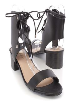 These sexy and stylish single sole chunky heels are a must have this season! The features include a faux leather upper with a strap vamp and open toe, ankle cuff with a front lace up tie design, smooth lining, and cushioned footbed. Approximately 2 1/4 inch heels.
