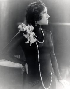 For those days when you just want everyone to step aside // Gloria Swanson in orchids and pearls