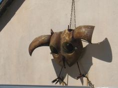 an owl decoration against a wall.