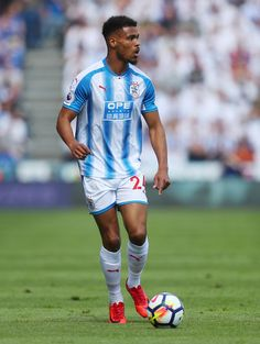 Steve Mounie Photos - Steve Mounie of Huddersfield Town during the Premier League match between Huddersfield Town and Arsenal at John Smith's Stadium on May 2018 in Huddersfield, England. Arsenal Premier League, Premier League Matches, Huddersfield Town, John Smith, Football, Running, Terriers, Squad, Sports