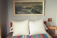 Eva and Jason's Charming Craftsman Bungalow — House Tour | Apartment Therapy  (art over sofa)