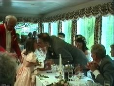 Pippa gets a kiss from her doting uncle as he hands over a gift to say thank you for being a bridesmaid