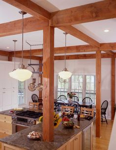 The Charleston post and beam cottage plan offers 10 ft ceilings throughout the first level. Visit to see floor plans and more.  #postandbeamplans