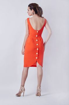 This coral short prom dress is so shiny and summertime! • The length is 102 cm ( the model on the photo is 172 cm tall) • Open sensual upper back • Slim fitting • 7 golden back buttons COMPOSITION: Exterior fabric- 100% crepe de viscose Interior fabric- 100% cotton Some more
