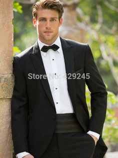 This mens tuxedo has a delicate pin striping on black adds a touch of texture while keeping things classic. Description from madamebridal.com. I searched for this on bing.com/images