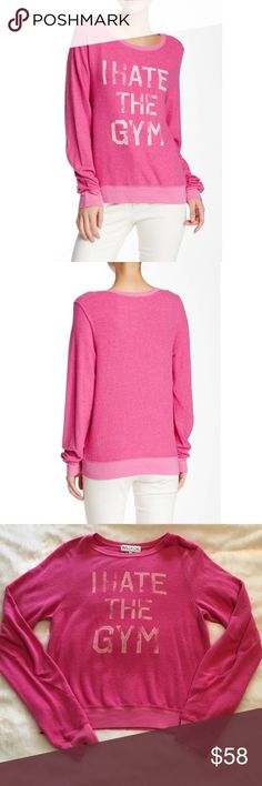 """🆕Wildfox I Hate the Gym BBJ NWOT Brand new without tags! Wildfox bright pink """"I Hate the Gym"""" Baggy Beach Jumper. Size M. Pre-pilled. Super soft and comfy. 47% polyester, 47% cotton, 6% spandex.  Letters are intentionally distressed. ❌NO TRADES❌NO LOWBALLING❌NO MODELING❌ Wildfox Tops Sweatshirts & Hoodies"""
