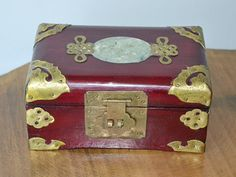 Check out this item in my Etsy shop https://www.etsy.com/ca/listing/277371848/jewelry-box-wood-brass-jade-jewelry-box
