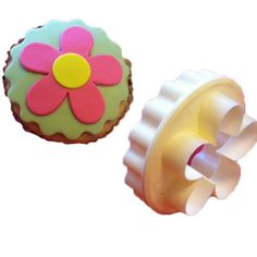It's a double-sided cupcake cutter! One side is scalloped edge- the other is a blossom.