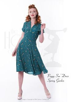 1940s 'Peggy Sue' Day Dress in spring garden print. Chartreuse green lucite style buttons on front...swoon  http://www.thehouseoffoxy.com/product/40s-peggy-sue-dress-spring-garden