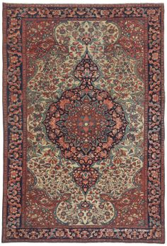 FERAHAN SAROUK, West Central Persian, 4ft 6in x 6ft 7in, Circa 1875. This singular antique Ferahan Sarouk Persian rug is another gem within the family's collection. Extraordinary fine knotting, closely cut pile and crystal clear drawing of even its most diminutive motifs create an atmosphere of ethereal grace to this collectible Persian town rug. Extraordinary balance within this 19th century rug's effusive shield medallion is harmonized by an alluringly earth tone and pastel palette.
