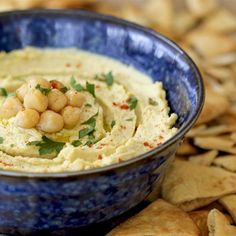 How to Make Perfect Hummus  Makes 5 cups Hummus     4 cups cooked garbanzo beans  2 cloves garlic  Juice of 4 lemons, or to taste  3/4 cup tahini  1/2 cup olive oil  1-1/2 t. kosher salt  pinch of cayenne pepper, (optional) if you like a little heat  reserved cooking liquid
