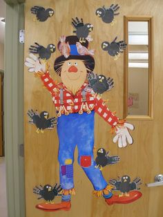 This is my new classroom door for the start of Fall! :)   Scare-ing away summer!   The scarecrow is actually an old decoration that a ...