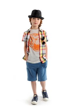 With a collection like APPAMAN, which offers the hippest items from hats right down to footwear, it's not easy narrowing to a few favorites. Here, brights work in a plaid shirt and tee, each shot with orange. Comfy shorts finish the look. www.appaman.com (editor's pick)