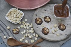 A disk of dark chocolate, a layer of chewy caramel, topped with three toasted macadamia nuts. Hand-made artisan chocolate by Bennetts of Mangawhai. Artisan Chocolate, Chocolates, Caramel, Vegetables, Dark, Handmade, Food, Sticky Toffee, Candy