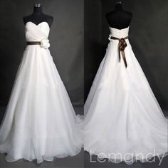 simple strapless sweetheart A line organza wedding dress with sash flower. $218.00, via Etsy.
