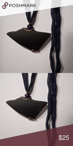 "black vintage glass pendant necklace with purple wonderful black vintage glass, resembling a bird taking flight, wrapped in bronze plated wire, and sitting atop is a faceted, luminescent purple glass bead. 2""h x 2 5/8""w. comes on a 32"" midnight blue fairy silk ribbon. klinsky Jewelry"
