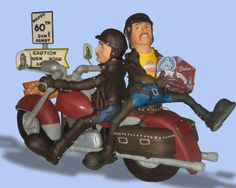 """This motorcycle-themed birthday cake was 3 1/2 ft. long x 2 1/2 ft. tall. With a base """"highway"""" cake, it served approximately 300. These non-identical twins were turning 60. They and their wives love to ride their  motorcycles cross country. Notice the wives in the mirrors."""
