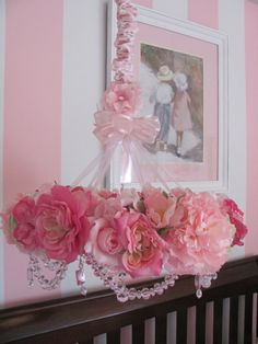 Use a wire ring for base and attach ribbons, crystal garland and then flowers.
