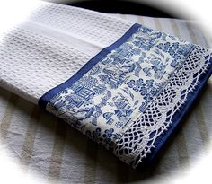 Handmade Willow ware theme decorative towel. Created by Cath using rare and out of print fabric with a gorgeous likeness to vintage willow ware china. Embellished with lace and sewn onto a white waffle weave cotton tea towel. This decorative dish towel would look fantastic in a blue and white theme kitchen. createdbycath.com