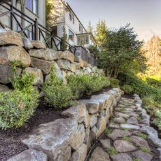 Stacked rock retaining wall