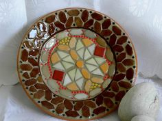 The big brown Mediterranean ceramic bowl - round, with mosaics.