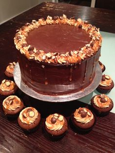 Chocolate and Salted Caramel Layer cake with Peanut butter frosting with flourless chocolate cupcakes with maltesers and salted caramel.