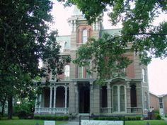 The haunted Woodruff-Fontaine House, 680 Adams Avenue, Memphis, USA. It is the daughter of the first owner, Mollie Woodruff Henning, that is said to haunt the house.