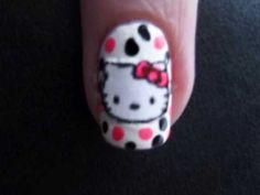 Best Hello Kitty nail tutorial!    When I did it, I filled in the bow and nose of the kitty BEFORE applying it to my nail, then if I screwed up, I could just print another one.