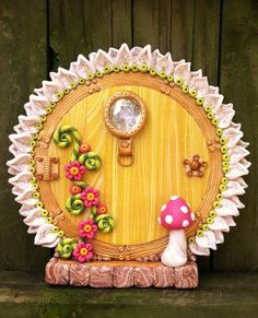 Darling Daisy Fairy Door pixie portal in polymer clay by pinkchihuahuacrafts Polymer Clay Fairy, Sculpey Clay, Polymer Clay Projects, Fairy Garden Doors, Fairy Doors, Clay Fairy House, Fairy Houses, Biscuit, Fairy Crafts